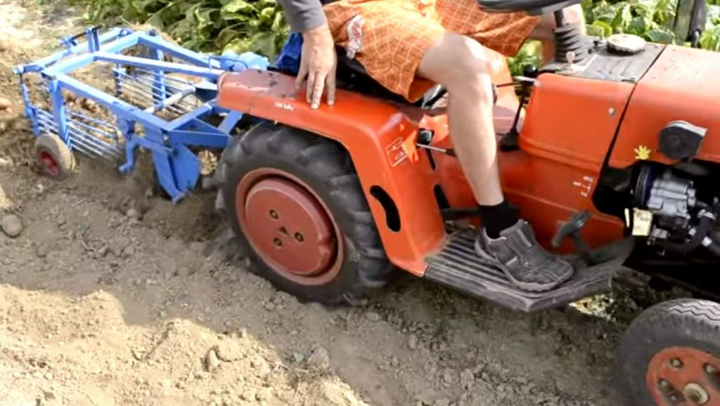 Subcompact Tractor with Potato Digger