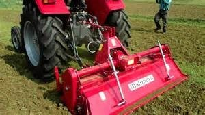 Compact Tractor with Bar Tires and Rototiller