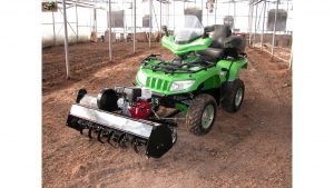 Self-propelled rototiller pushed by ATV
