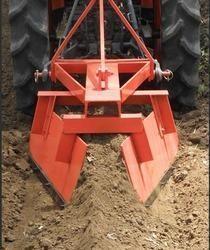 Bund bulder on compact tractor