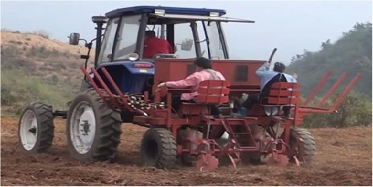 Tractor planting cassava